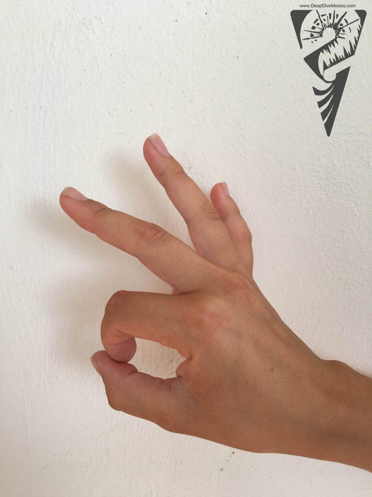 Handzeichen Tauchen